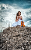 The red-haired girl with a violin Royalty Free Stock Image