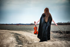 The red-haired girl with a violin Stock Photo