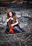 The red-haired girl with a violin Stock Images
