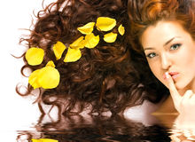 Red-haired girl and water reflection Stock Image