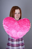 Red-haired Girl With Heart Toy. Royalty Free Stock Image