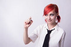 Red-haired girl writing marker royalty free stock photos