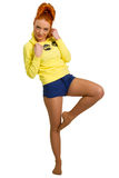 Red-haired girl in a yellow jacket Royalty Free Stock Image