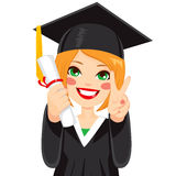 Red Haired Graduation Girl. Beautiful red haired girl on graduation day with diploma and making victory sign with hand Stock Images