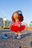 Red-haired handmade doll with a toy car Stock Photos