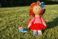 Red-haired handmade doll with a toy car Stock Images