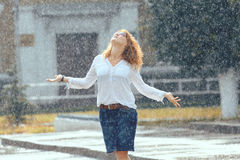Red-haired happy woman in the rain Stock Photo