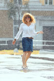 Red-haired happy woman in the rain. Portrait of red-haired happy woman in the rain Stock Photo