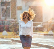 Red-haired happy woman in the rain Royalty Free Stock Photo