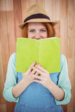 Red haired hipster reading a book Royalty Free Stock Photos