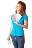 Red-haired Jugendlichmädchen mit Geld in der Hand Stockfotos