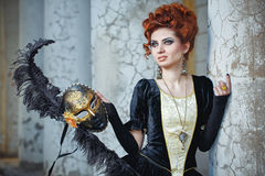 Red-haired lady in mask Royalty Free Stock Image