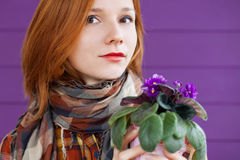 Red-haired lady with violets Stock Photo