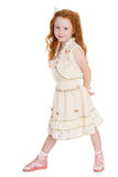 Red haired little girl of six years Stock Photo