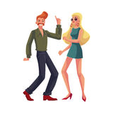 Red haired man, blond woman 1970s style clothes dancing disco Stock Photography