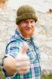 Red haired man with blue plaid shirt saying Ok Royalty Free Stock Photos