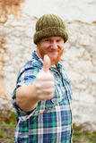 Red haired man with blue plaid shirt saying Ok Stock Images