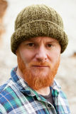 Red haired man with blue plaid shirt Stock Image