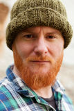 Red haired man with blue plaid shirt Stock Images