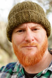 Red haired man with blue plaid shirt Royalty Free Stock Photo