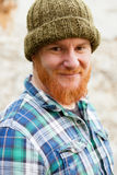 Red haired man with blue plaid shirt Stock Photo