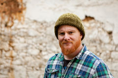 Red haired man with plaid shirt looking at camera Royalty Free Stock Photo
