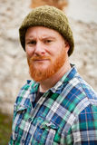 Red haired man with plaid shirt looking at camera Stock Image