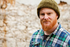Red haired man with plaid shirt looking at camera Stock Photo