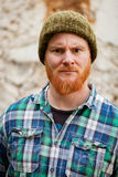 Red haired man with plaid shirt looking at camera Royalty Free Stock Image