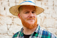 Red haired man with a straw hat Royalty Free Stock Photography