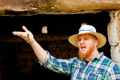 Red haired man with a straw hat Stock Photography
