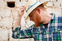 Red haired man with a straw hat Stock Photos