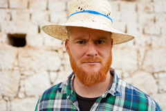 Red haired man with a straw hat Royalty Free Stock Images