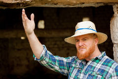 Red haired man with a straw hat Royalty Free Stock Image