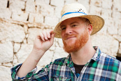 Red haired man with a straw hat Stock Photo