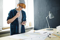 Red Haired Man using Smartphone in Office Stock Photography