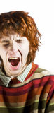 Red-haired man yawning Stock Photo