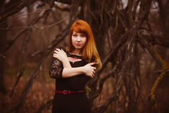 Red-haired model girl black woman dress autumn Royalty Free Stock Image