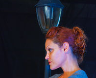 Red Haired Model By A Lamp Stock Photo