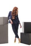 Red-haired model posing in sexy business clothes Royalty Free Stock Image