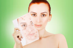 Red haired model releases her sjin from blemishes. Red haired female model releases her sjin from blemishes Stock Image