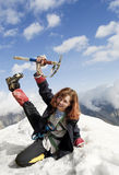 Red-haired mountaineer girl. Cheering at the top of a high mountain royalty free stock photo