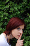 Red-haired near green tree Royalty Free Stock Images