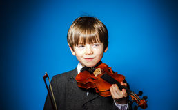 Red-haired preschooler boy with violin, music concept Stock Photo