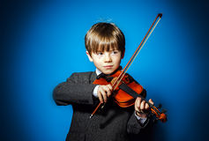 Red-haired preschooler boy with violin, music concept Royalty Free Stock Photos