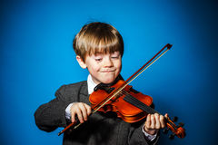 Red-haired preschooler boy with violin, music concept Royalty Free Stock Photography