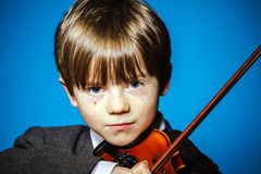 Red-haired preschooler boy with violin, music concept Royalty Free Stock Images