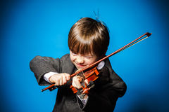 Red-haired preschooler boy with violin, music concept Stock Image