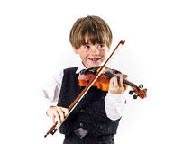 Red-haired preschooler boy with violin Stock Photo