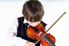 Red-haired preschooler boy with violin Royalty Free Stock Images
